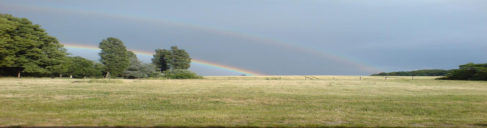 Doppelter Regenbogen über dem Gäste- und Ferienhaus Uckermark